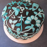 Java Blue Chocolate cake with chocolate buttercream. Covered in chocolate fondant and decorated to look like the Vera Bradely Java Blue pattern.