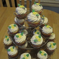 Cupcake Tree Lemon cupcakes placed on a cupcake tree stand