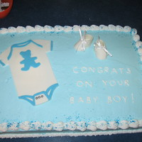 Baby Shower Cake Buttercream covered cake with fondant baby booties that I made.