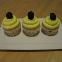 Lemon Cupcake Lemon cupcake with lemon buttercream and fresh blackberry on top