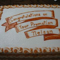 Promotion Cake Promotion cake, bc iced with hand drawn ribbon banner. No flowers for this man.
