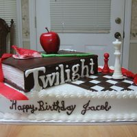 Twilight Cake BC iced book & cake, book cover & all items are made of candy clay except the apple it's fake. Twilight lettering was white...