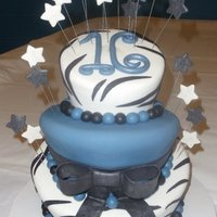 Black & Blue Sweet 16   My first attempt at a topsy turvey cake for my nieces sweet 16.