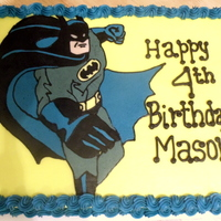 Batman!   Half sheet cake with fbct of batman.