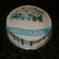 Baby Shower Train Cake Strawberry cake with buttercream; fondant accents. I was given a picture of a cake made by Simply Sweets and a napkin (made by Carter'...