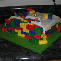 Lego Cake Made for my son's 8th birthday--he's obsessed with legos. I've seen lots of variations of this cake on CC and knew my son...