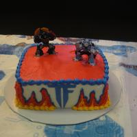 Transformers Cake White Chocolate with milk chocolate truffle filling for twin boys b-day. They had a joint party with their little sister (she had...