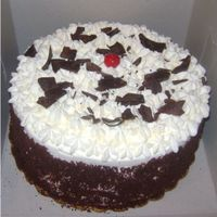 Black Forest Cake This is to die for. 4 Layers of Chocolate Cake w/ cherry liquor simple syrup filled and iced with fresh whipped cream & cherries,...