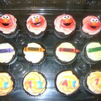 Elmo Cupcakes These were made to go w/ the Elmo cake. I cheated and bought the toppers from the cake decorating store, but I still love them! I think...