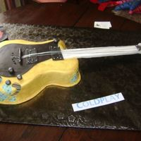 Electric Guitar This was a 12 x 18 marble sheet cake filled with cookies n cream. I got instructions from adven68 - thank you! I printed a huge template...