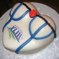 Super Bowl Bustier This was my first bustier cake. Next time, I will use a bigger heart shape. Also, I used mini sports balls for the boobs, and I should'...