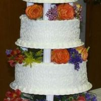 Cornelli Lace Wedding Cake I made this multi tiered wedding cake for my niece. Her colors were orange, purple, and lime so I told her I'd do it in white and she...