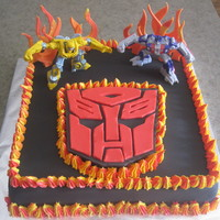 Transformers Cake Cake made with buttercream and fondant except for the 2 transformers on the top of cake (toys). Thank you to all the CC members for the...