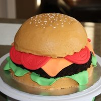 "Hamburger 10"" chocolate cake covered in BC with fondant accents. The hamburger patty is covered in chocolate BC and then oreo cookie crumbs. TFL..."