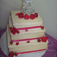 Simple Square Wedding Cake BC icing, sugar flowers, ribbons & pearls