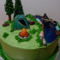 Camping Birthday Chocolate cake with chocolate mousse filling. Rocks are candy rocks, water is colored piping gel, one tree is ice cream cone with leaves,...