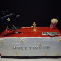 Hollywood Birthday Cake cake covered in buttercream with fondant red carpet. The movie camera was a rice crispy treat covered in fondant.