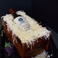 Sugar Wine Bottle Cake Double Choc cake with peanut butter filling. Box is painted fondant, straw is chocolate modeling paste, and bottle is sugar. Label is...