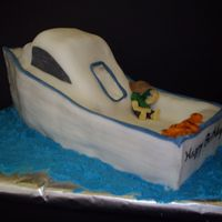 Chesapeake Bay Fishing Boat This is a white cake covered in fondant. I created the lines that looked like wood slats by cutting lines then dusting with luster powder....