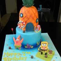 Spongebob Square Pants Birthday Cake Vanilla Cake w/ Buttercream icing. Everything is edible, the characters are made out of gum paste. Thanks for looking!
