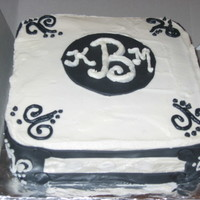 Monogrammed 9 inch square cake. Marble fudge covered with vanilla buttercream and fondant accents. This was done for a co-ed wedding shower. I found...