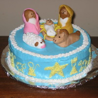 The Nativity In honor of the birth of Christ, I put together this little cake.depicting Mary, Joseph and the baby Jesus. On the sides of the cake, you...