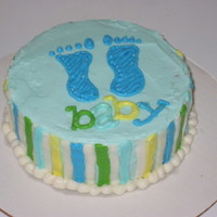 Baby Boy This cake was custom made to match the shower invitation. The order was for cake and matching cupcakes. Chocolate cake with vanilla...