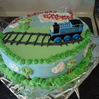 Thomas The Tank Engine This cake was done for a friend's little guy who is really into Thomas right now. The cake is french vanilla with vanilla buttercream...