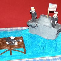 Navy Retirement Cake Carved and iced in butterceam. the figures are hand molded from gum paste. I had some serious engineering issues, but overall, a huge...