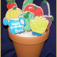 Vegetable Garden Cookie Bouquet NFSC iced with royal icing. Cookies are custom cut from images from the internet. I couldn't find the shapes I wanted in cookie...