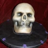 3D Airbrushed Skull Wilton 3D skull pan. Red Velvet cake, fondant, airbrush. Marbled fondant cake board. First time really doing a 3D cake and using the...