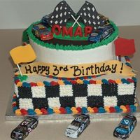 Nascar Theme Cake 2 tiers choc and vanilla all BC. The flags are chocolate transfers and the cars are foiled covered chocolate I bought.