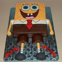 Sponge Bob Cake is double layer chocolate and vanilla filled with buttercream and iced in buttercream. His bottom half is covered in white chocolate...