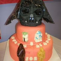 Star Wars Cake This is the front view of my little brothers 8th birthday cake. I did not liek the darth vader head at all but he insisted i put it on. It...