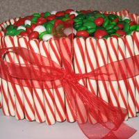 Christmas Candy Barrel Cake  My first candy barrel cake. It was quite a hit at work. Someone even started eating the cand off of it thinking it was a bowl of M&Ms....