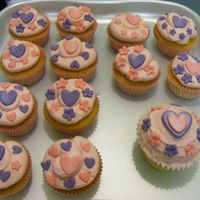 Pink & Lilac Cupcakes Pink almond buttercream with fondant and edible glitter.