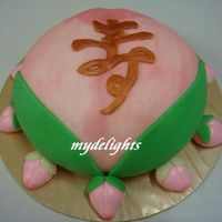 Longevity Peach   Birthday cake for a grandpa. This fruit signifies longevity to the Chinese.