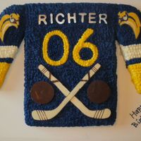 Hockey Jersey 6th birthday cake for a Buffalo Sabres hockey fan.