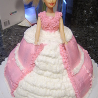 Barbie Cake  White and chocolate cake covered in buttercream. First barbie cake. I think it came out ok but, I learned a few things I will do different...