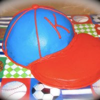 Baseball Hat Cake I did this cake for my best friend's little boy's 1st birthday...he didn't want to put his hands in it LOL First time I did...