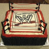 "Wwe Birthday Cake French vanilla cake, vanilla buttercream. Edible image with WWE Logo. Was disappointed that I couldn't get the ""strings"" on..."