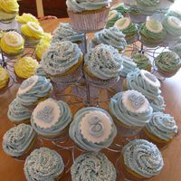 Img_0459_1.jpg Baby shower cupcakes. Vanilla cake, vanilla buttercream swirls, fondant decorations. Thanks for looking.
