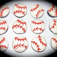Baseball Cupcakes Also for my best friend's little boy's 1st birthday...to go with the baseball cap cake. These were so much harder than I thought...