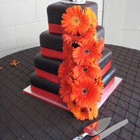 Brown And Orange Square Wedding Cake Brown and orange square wedding cake decorated with fresh orange Gerberas.