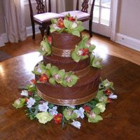 Dscf3446.jpg 3-tiered chocolate wedding cake with chocolate icing, orchids and roses