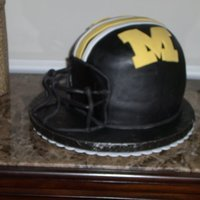Mu Helmet Chocolate cake with carmel filling and fondant icing .I used soccer ball pan and 2 9 inch cakes and then carved them.Thak you every one who...