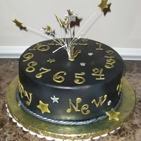 2011 9 inch chocolate chip cookie cake with carmel pecan filling .Icied and decorated with fondant, with a hint of gold and silver air brushing...