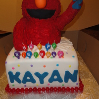 Elmo Elmo cake made for a 2 year old boy. Balloons were added in his hand after delivery and set up.