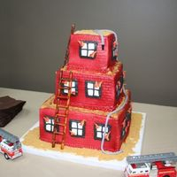 Fireman's Groom's Cake   This was all buttercream with fondant accents. TFL!
