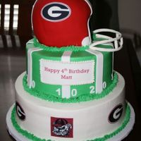 Georgia Bulldog Birthday Cake This was buttercream with fondant accents, helmet all fondant with gumpste accents. TFL!